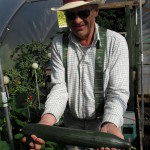 John shows off his prize cucumber (John plot 9)
